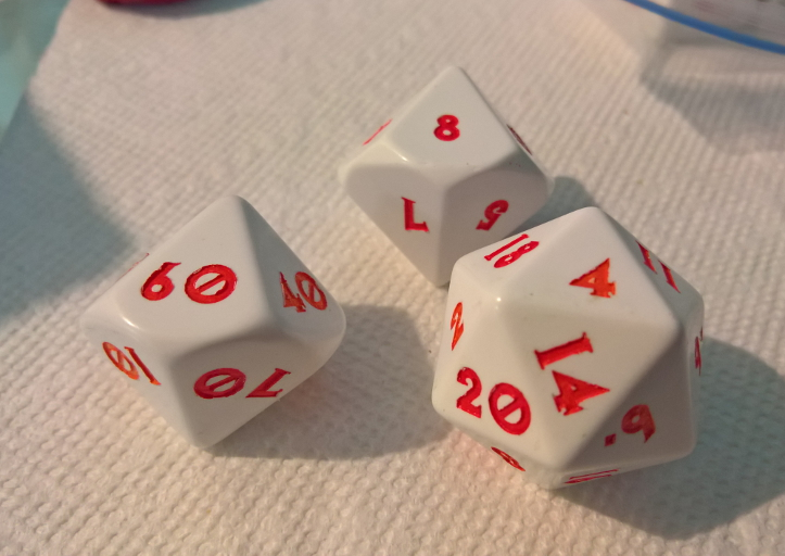 Examples of two D8s (eight-sided die) and a D20 (20-sided die) with a custom font